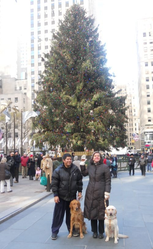 Beth and her classmate in front of the Christmas tree at Rockefeller Center.