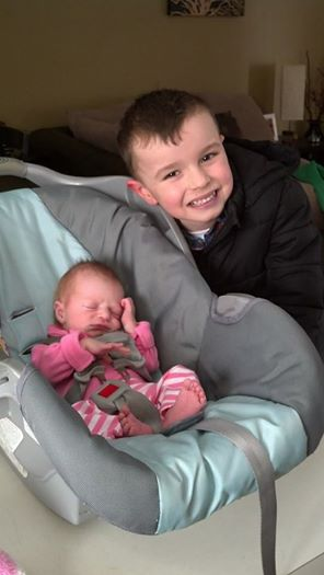 That's Ella--her brother Bryce is happy to have a sister.