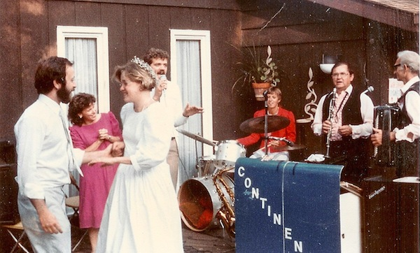 Dancing on our wedding day. Roland Kwasny and the Continentals played. On this number, Beth's sister Bev sat in on the drums, our friend Keith Pickerel was crooning, and the lovely woman in red next to him is Ree Stone.
