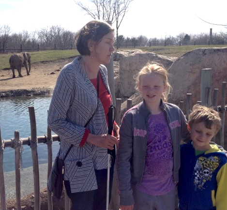 That's Floey and Ray with Great Aunt Beth at the Indianapolis zoo. We didn't catch the elephant's name.