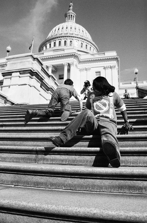 Disable demonstrators crawl the Capitol steps. Photo: Action for Access, Tom Olin