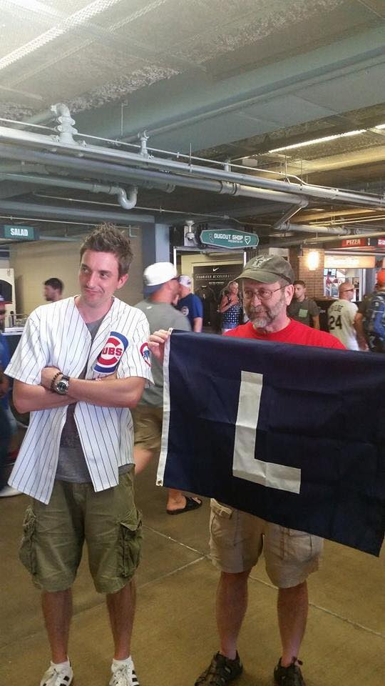 Last year Mike went to a Cubs-Sox game with some members of my family, including my nephew, Brian. The Sox won, the L flag came out, and Brian couldn't quite believe it (Also note Mike's ballcap:Marlins).