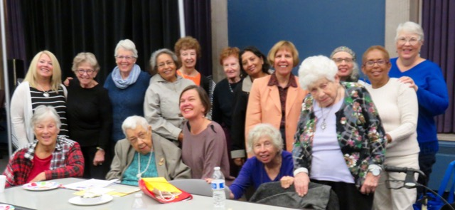 Author Beth Finke looking very happy surrounded by members of her memoir writing class for seniors