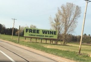 Picture of a billboard that says free wine.