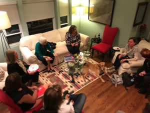 Photo of women gathered in a living room.