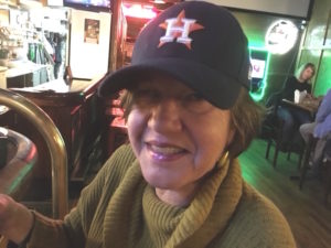 Picture of Beth in Astros cap.