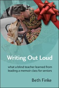 Photo of cover of Writing Out Loud with a Christmas bow.